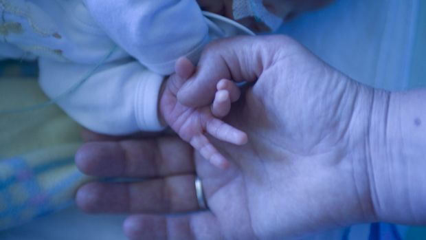 Police are investigating after a baby was left on the verandah of a Herston home.