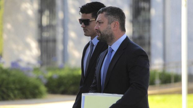 Jordan Sharma with his lawyer Kamy Saeedi. Sharma has been accused of an assault which broke another man's jaw during ...