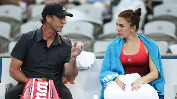 Simona Halep talks to her coach Darren Cahill between games in Sydney.