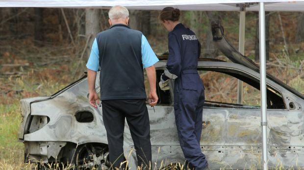 Homicide Squad detectives have joined the search for a missing woman who's burnt out car was found in Myrtleford.