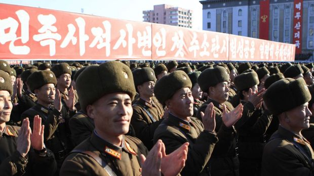 North Korean military personnel clap hands in a rally, after North Korea said it had conducted a hydrogen bomb test ...