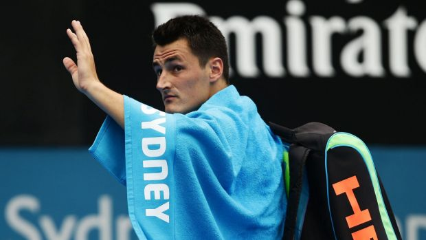 Farewell: Bernard Tomic waves to the crowd at Sydney Olympic Park Tennis Centre on Friday.