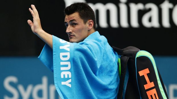 Farewell: Bernard Tomic waves to the crowd at Sydney Olympic Park Tennis Centre after withdrawing from his quarter-final.