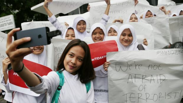 An Indonesian student takes a selfie during a rally for solidarity on Friday following the attacks in Jakarta on Thursday.