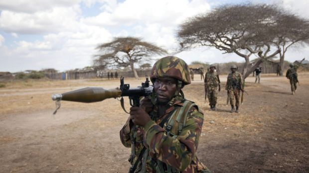 A Kenyan army soldier carries a rocket-propelled grenade launcher as he patrols Tabda, Somalia.