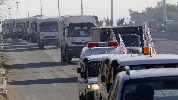A convoy of trucks loaded with humanitarian supplies are heads to the besieged town of Madaya, some 45 kilometers from ...