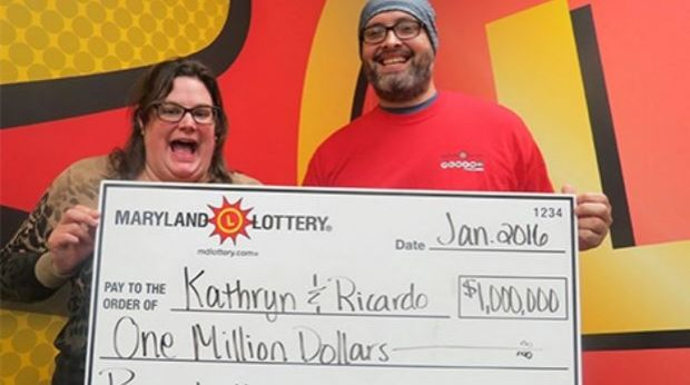 Kathryn and Ricardo with their oversized lottery cheque.