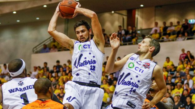 Melbourne United's Todd Blanchfield pulls in a rebound against Cairns on Friday night.