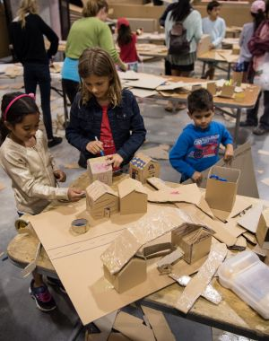 Children take part in the community project.
