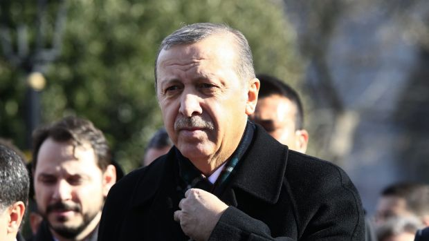 Turkey's President Recep Tayyip Erdogan visits the site of a suicide bombing in Istanbul.