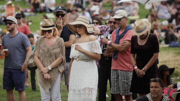 Festival goers during the minute silence at the So Frenchy so Chic in the Park.