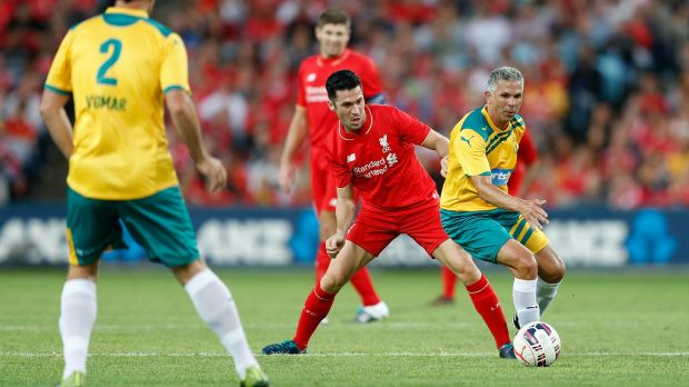 Still got it: Luis Garcia tackles Steve Corica during the Liverpool Legends v Australian Legends match.