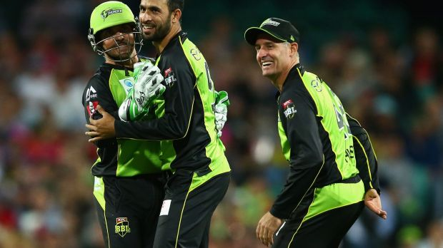 All over: Fawad Ahmed of the Thunder celebrates dismissing Johan Botha of the Sixers.