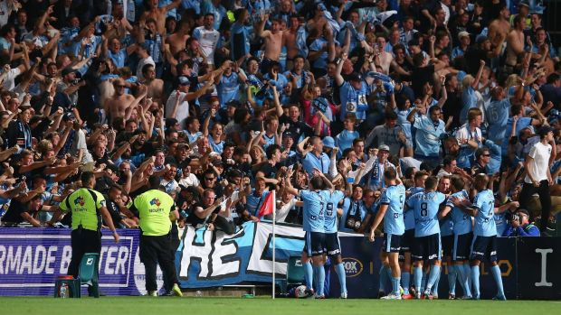 Who run's this town?: Sydney FC players celebrate with fans after winning the Sydney Derby.