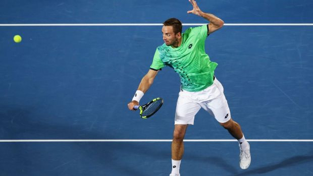 Triumphant: Viktor Troicki of Serbia plays a backhand volley.
