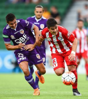 Jacob Collard of Perth Glory challenges Bruno Fornaroli of Melbourne City.