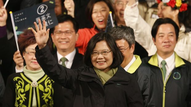 Tsai Ing-wen raises her hands as she declares victory in the island's presidential election.