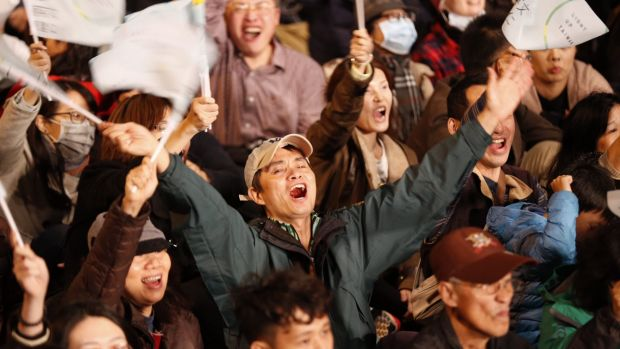 Jubilant scenes at the Democratic Progressive Party headquarters in Taipei as early numbers suggested Tsai Ing-wen was ...