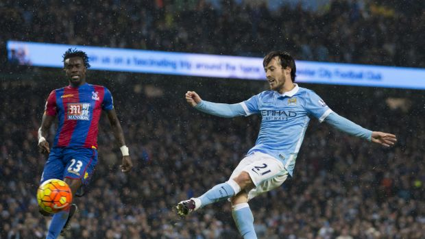 Golden touch: Manchester City's David Silva scores past Crystal Palace's Pape N'Diaye Souare during the English Premier ...
