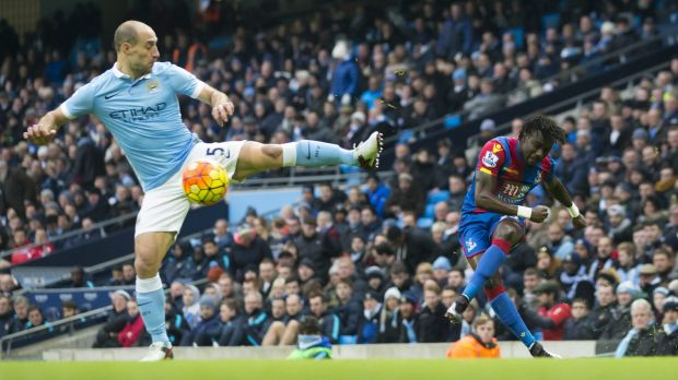 Karate stance: Crystal Palace's Pape N'Diaye Souare crosses a ball past Manchester City's Pablo Zabaleta.