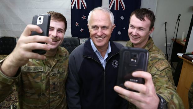 Prime Minister Malcolm Turnbull appears in selfies with Lieutenant Joshua Armstrong, 26, and Lance Corporal Lincoln ...