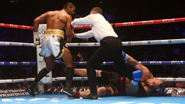 Heavy blow: David Haye is pushed away by the referee after knocking out Mark De Mori at The O2 Arena in London.