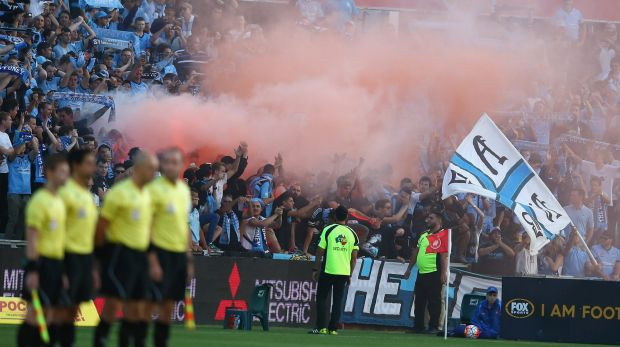 Smokescreen: Sydney FC supporters set off a flare before play in the round 15 A-League match between the Western Sydney ...