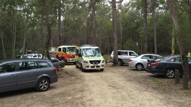 Emergency services at the foot of the mountain on Sunday morning.
