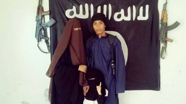 Malaysian police say  Muhammad Wanndy Mohamad Jedi (right) has been using social media to recruit Malaysians and plot ...