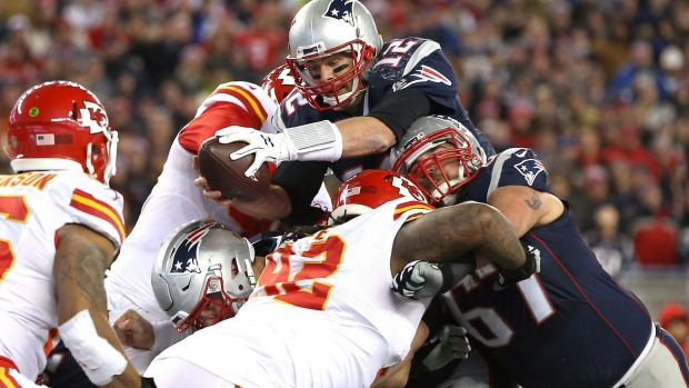 Tom Brady of the New England Patriots scores a touchdown in the win against the Kansas City Chiefs.