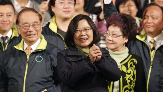 Taiwan's Democratic Progressive Party, DPP, presidential candidate Tsai Ing-wen waves as she celebrates winning the ...