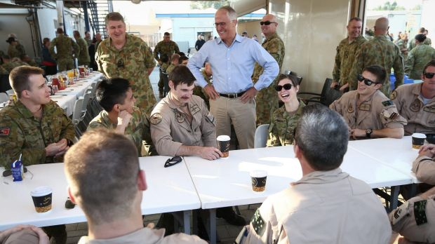 Prime Minister Malcolm Turnbull meets with troops during breakfast at Camp Baird in the Middle East.