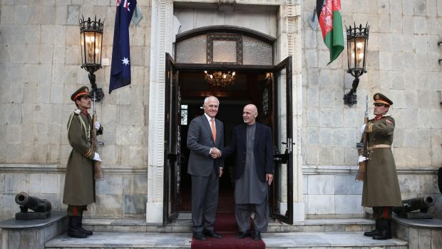 Mr Turnbull and Dr Ghani outside the palace.
