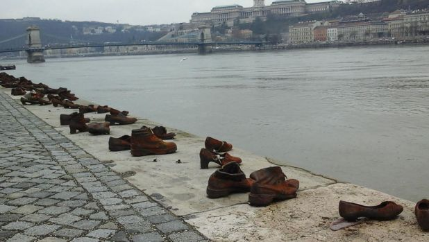 Shoes line the bank of the Danube River in Budapest in a memorial to Jewish victims in Hungary during World War II ...