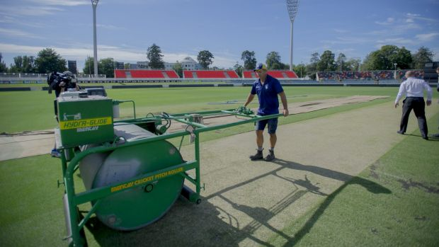 The Manuka Oval pitch gets its final touches before Wednesday's one day international match by curator Brad Van Dam.
