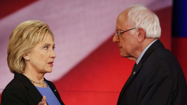 Democratic presidential candidates Hillary Clinton and Senator Bernie Sanders speak during a break in Charleston, SC.