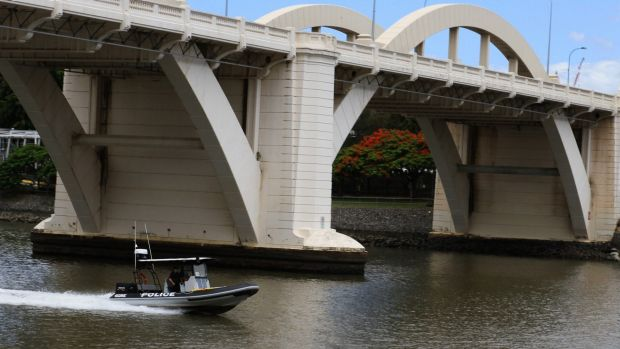 Police continue to search the Brisbane River.