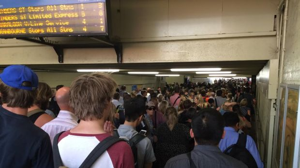 Crowds at Caulfield station wait for replacement buses following a train disruption on the Frankston line.