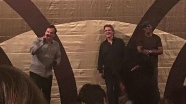 Quentin Tarantino on stage in Yarraville with Kurt Russell and Samuel L. Jackson.