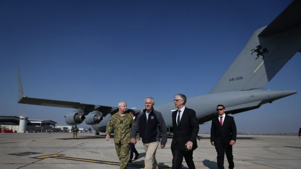 Prime Minister Malcolm Turnbull, centre, exits a C-17 Globemaster after arriving in Baghdad, Iraq, during a visit to ...