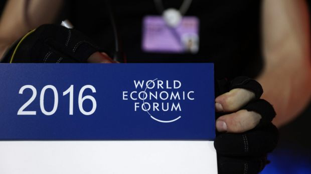 A worker prepares a speaker's podium for a panel session ahead of the World Economic Forum (WEF) at the Congress Centre ...