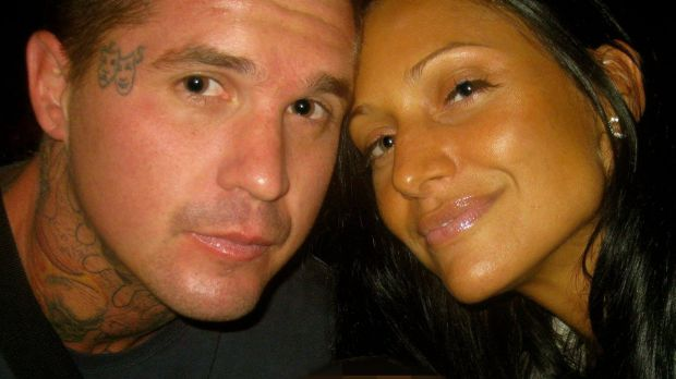 Slain bikie Mark Easter  (pictured with partner Biancha Simpson) was shot dead and left on the side of the road on the ...