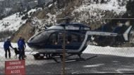A rescue helicopter responds to after an avalanche emergency in the French Alps.