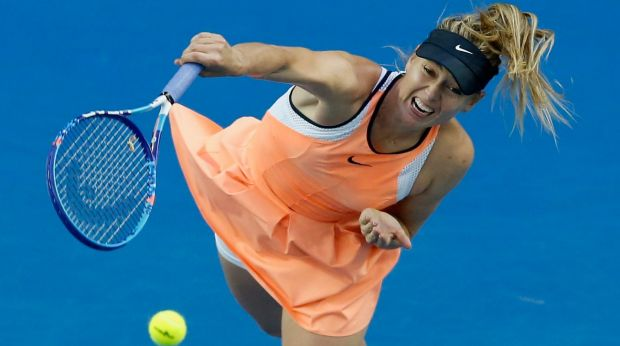 Maria Sharapova shows orange has more grunt on a blue court.