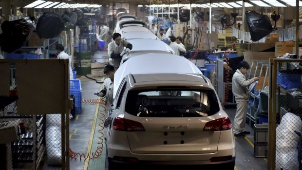 Chinese workers labour on the assembly line of the X5 SUV of Zotye Auto in Hangzhou in east China's Zhejiang province.