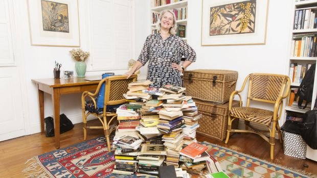 Susan Wyndham after clearing out her bookshelves under the guidance of decluttering expert Kim Carruthers in 2013.