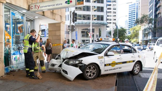 The taxi jumped the curb, smashing into a convenience store.