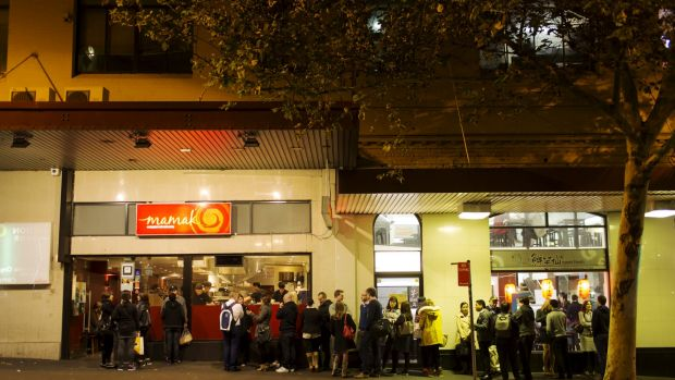 People queuing up to enter Mamak restaurant in China Town, Sydney.