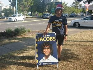 LNP candidate for The Gabba, Sean Jacobs, with his Brisbane City Council-inspired corflute.
