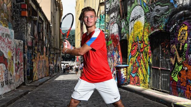 Omar Jasika gets some time away from the Australian Open in Hosier Lane.
